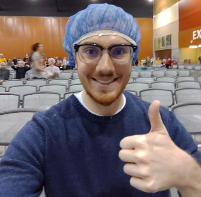 A volunteer giving a thumbs up